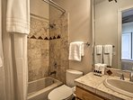 Rise and shine with a steamy rinse in this shower/tub combo.