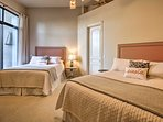Up to 4 guests can share this room with 2 queen-sized beds.