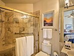 This bathroom houses a spacious walk-in shower.