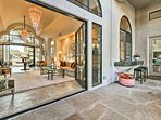 French doors lead you to the property's resort-like backyard.