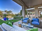 Balmy days are well spent lounging on this furnished patio.