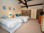 Spacious double with single bed and en-suite shower room