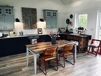 The modern kitchen and dining area of Foxglove Cottage