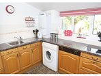 Fitted kitchen with dishwasher nd washing machine