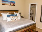Great walk-in close with shelves and hangers and luggage racks