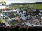 Aerial Picture of Croft Acre Holiday Cottages in Port Eynon and its nearby available facilities .