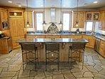 Gourmet Kitchen with granite counters, quartzite floors, professional Viking range