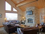 Main living area has an extra large fireplace, HDTV with surround sound