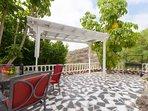 Rear terrace positioned in beautiful gardens.
