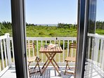 The balcony and view off the master bedroom at Sea Change Cottage