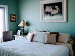Bedroom #1 - King bed, dresser, smart HDTV, French doors open to front veranda.