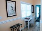 Small writing desk and window to front veranda.