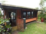 back exterior of Ema's Fale with well kept garden and also access to a 2nd private toilet