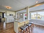Enjoy your morning coffee at the 3-person breakfast bar in the kitchen.