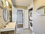 In-unit laundry machines are also located in the bathroom.