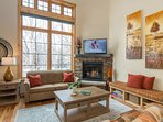 Family room with gas fireplace, flat screen TV, and views of Howelsen Hill