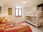 The second bedroom with bunk bed