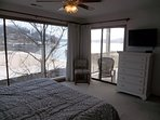 Great view of lake, flat screen TV, and access to the balcony from the bedroom