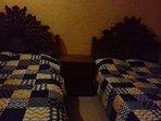 Recamara 3 con dos camas matrimoniales y una cama individual