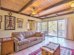 Find refuge from the sun under the living room's exposed beam ceilings.