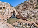 This home is nestled on the shores of the Jemez River and sleeps 6.