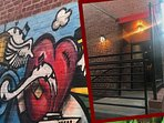 Street art in alley leading to Anxo Cidery & Tasting Room (left), Entrance (right)