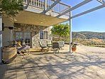 Lounge on the spacious covered patio with tasty refreshments.