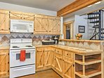 You're sure to admire the beautiful pine custom cabinetry.