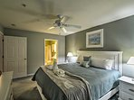 Enjoy a restful night's sleep in this king master suite.