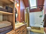 Wash up before bed in this full bathroom.