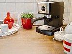 De'Longhi espresso maker,  french press and American-style coffee maker.
