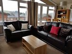Comfortable living room with french doors leading to terrace.