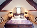 The master bedroom comes complete with the largest of beds and best of nights sleeps
