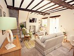 The original oak beams add lots of character to the pretty living space