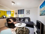 Our lovely open plan living area means no one is banished to the kitchen, away from the fun.