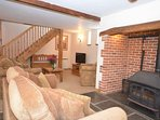 Open plan living area with cosy woodburner