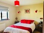 Sunny front double bedroom with en suite shower room