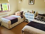 Twin bedded room, light and bright