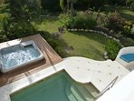 View of pool/jacuzzi and a bit of our private garden from the upstairs terrace