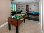 Community game room with pool and foosball tables