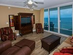 Wood-tiled living room with 14th floor Gulf-front views