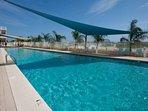 Community pool overlooking beach and Gulf