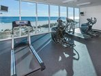 Fitness center overlooking beach and Gulf