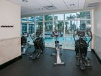 Community fitness center overlooking pool