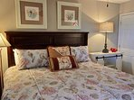 Guest bedroom with king bed and double closet