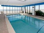 Indoor pool overlooking beach and Gulf
