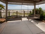 Patio with swings overlooking beach and Gulf