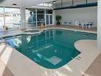 Indoor pool overlooking outdoor pool