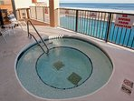 Built-in hot tub with pool, beach and Gulf in background