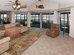 Living room overlooking screened porch and lagoon view